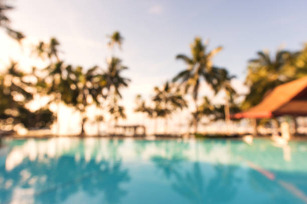 Tropical swimming pool defocused abstract background stock photo