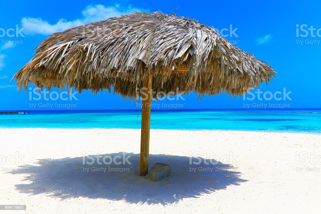 Tropical turquoise Mayan riviera Beach with thatched roof palapa, Cancun, Mexico – Caribbean sea stock photo