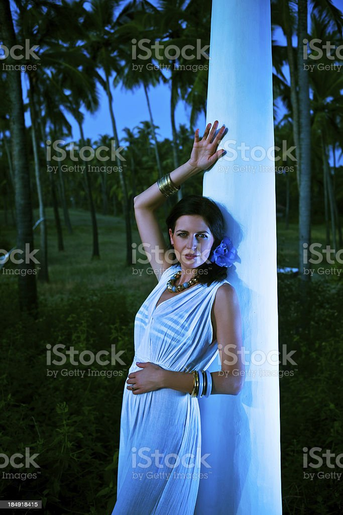 Tropical vacation Beautiful woman enjoying tropical vacation. Coconut palm trees in the background.  30-34 Years Stock Photo