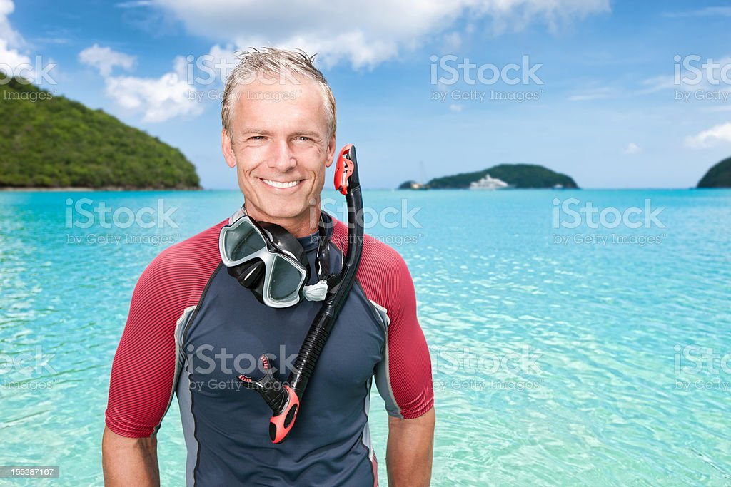 Tropical Vacation: Retired Snorkeling Man royalty-free stock photo