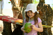 Girl drinking from a fresh coconut in Costa Rica