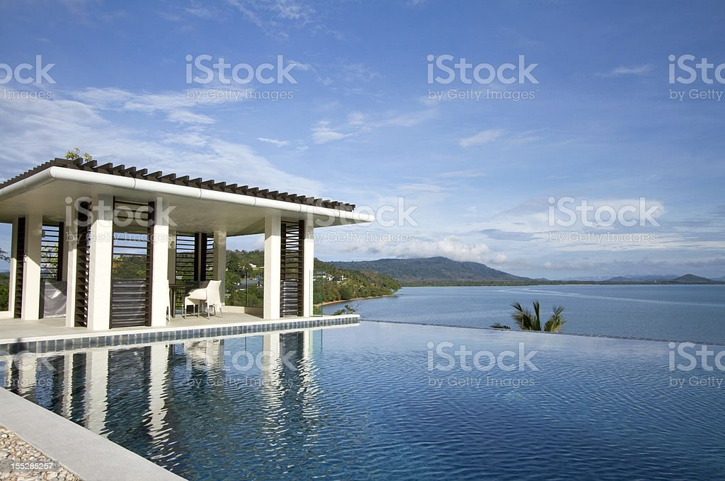 Tropical villa swimming pool facing the sea royalty-free stock photo