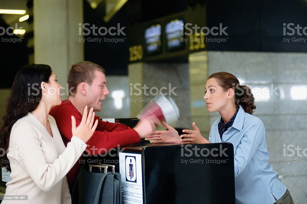 Trouble at the check-in desk royalty-free stock photo