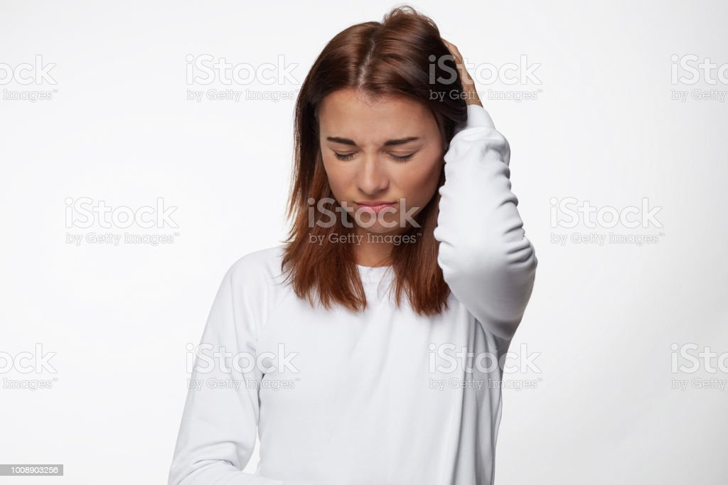 Troubled Beautiful Young Female With Dark Red Hair Keeps Hand On