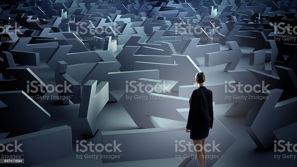 Troubled businesswoman finding way out . Mixed media stock photo