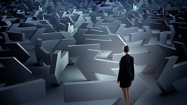 troubled businesswoman finding way out . mixed media - maze stock photos and pictures