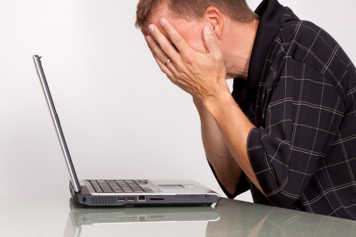 Troubled Man With Laptop Computer Stock Photo - Download Image Now