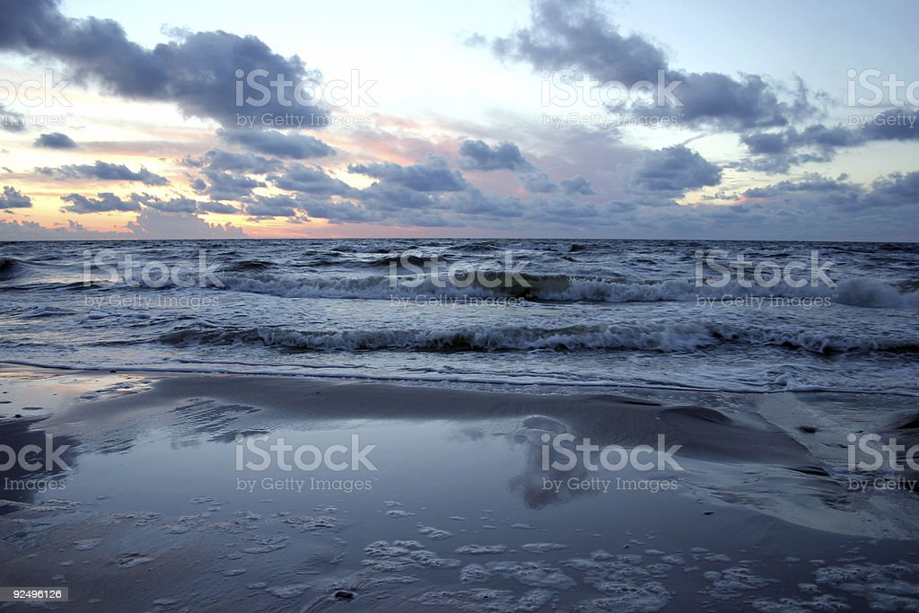 Troubled sea at sunset royalty-free stock photo