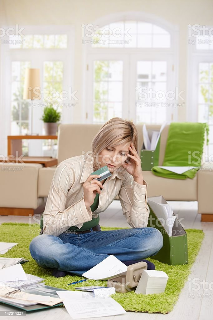 Troubled woman with credit card stock photo