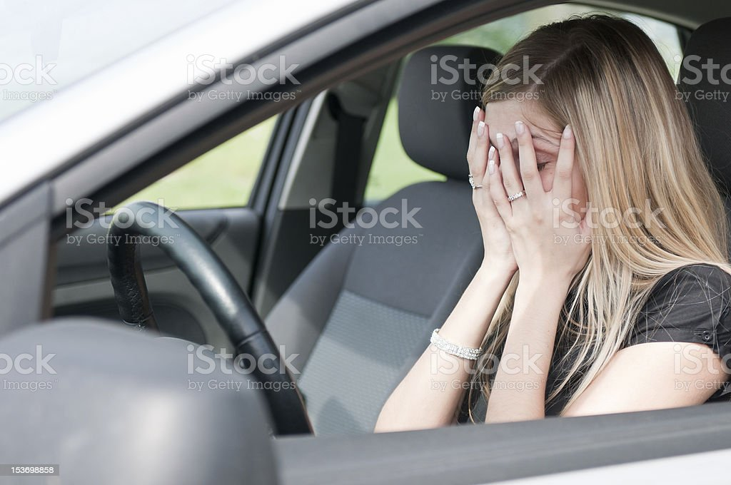 Troubles - unhappy woman in car royalty-free stock photo