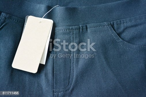 Close up trouser and blank label.
