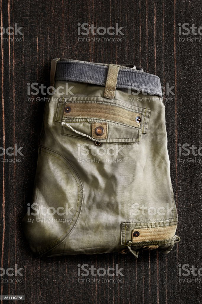 Trousers on wooden background royalty-free stock photo