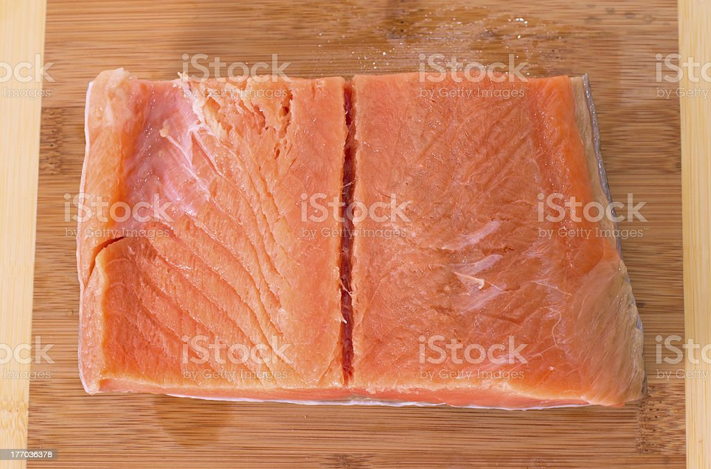 Trout fillet on wooden background royalty-free stock photo