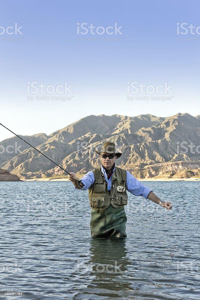 Trout fisherman royalty-free stock photo
