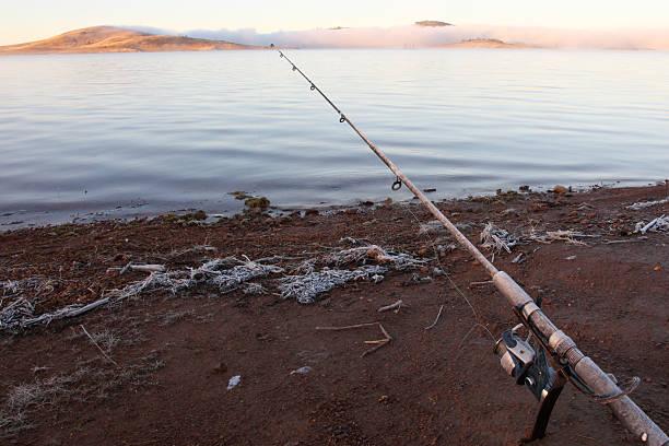trout fishing at lake eucumbene, nsw australia - lake eucumbene stock photos and pictures