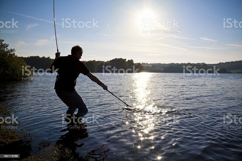Trout Flyfishing Catch from Lake Bank stock photo