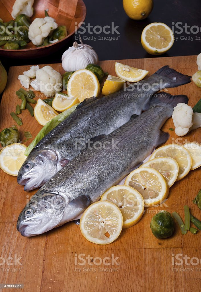 Trout in lemons royalty-free stock photo