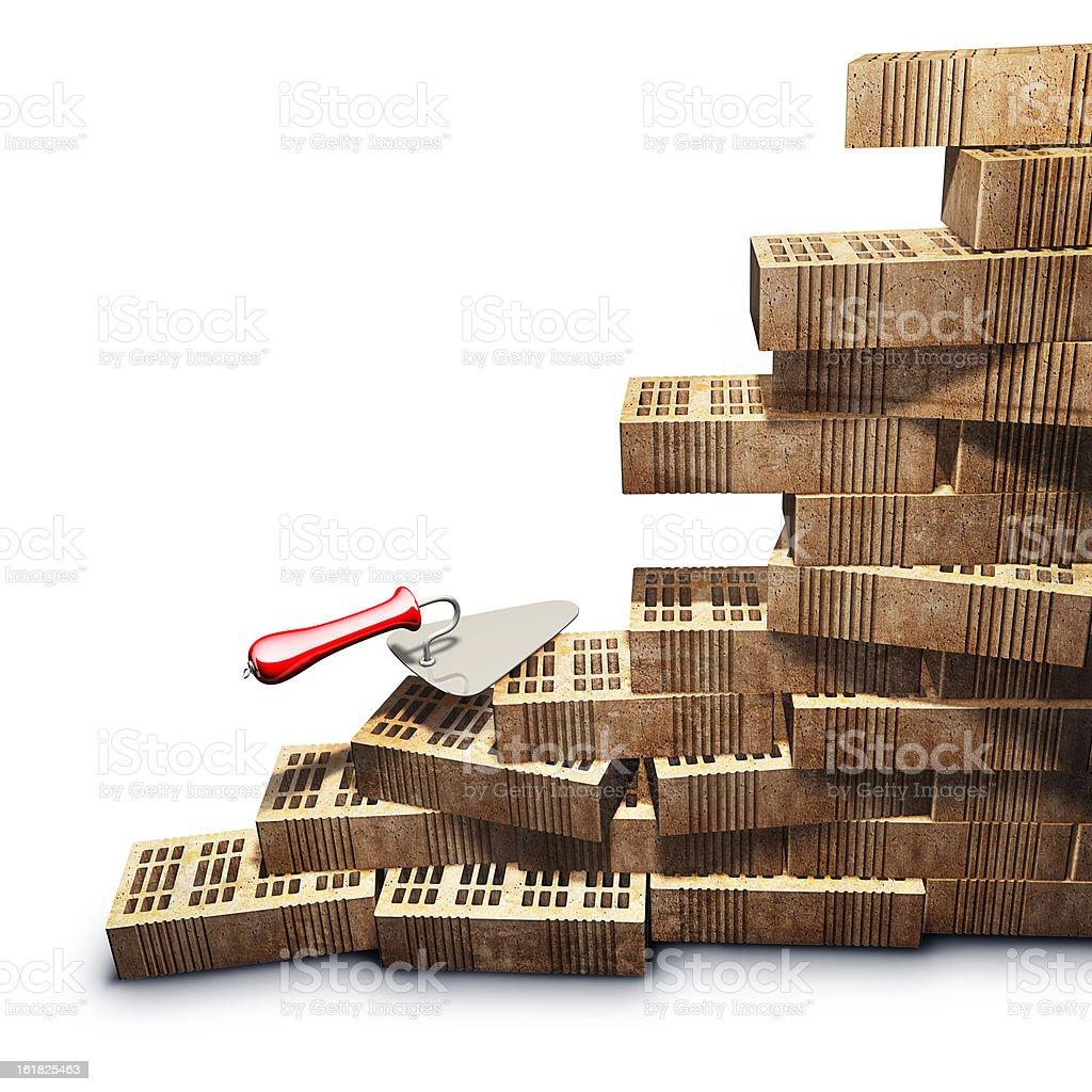 Trowel and bricks wall construction royalty-free stock photo