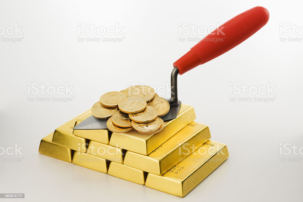 Trowel and Gold Coins. royalty-free stock photo