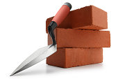 A trowel sitting atop a pile of bricks.Please see some similar pictures from my portfolio: