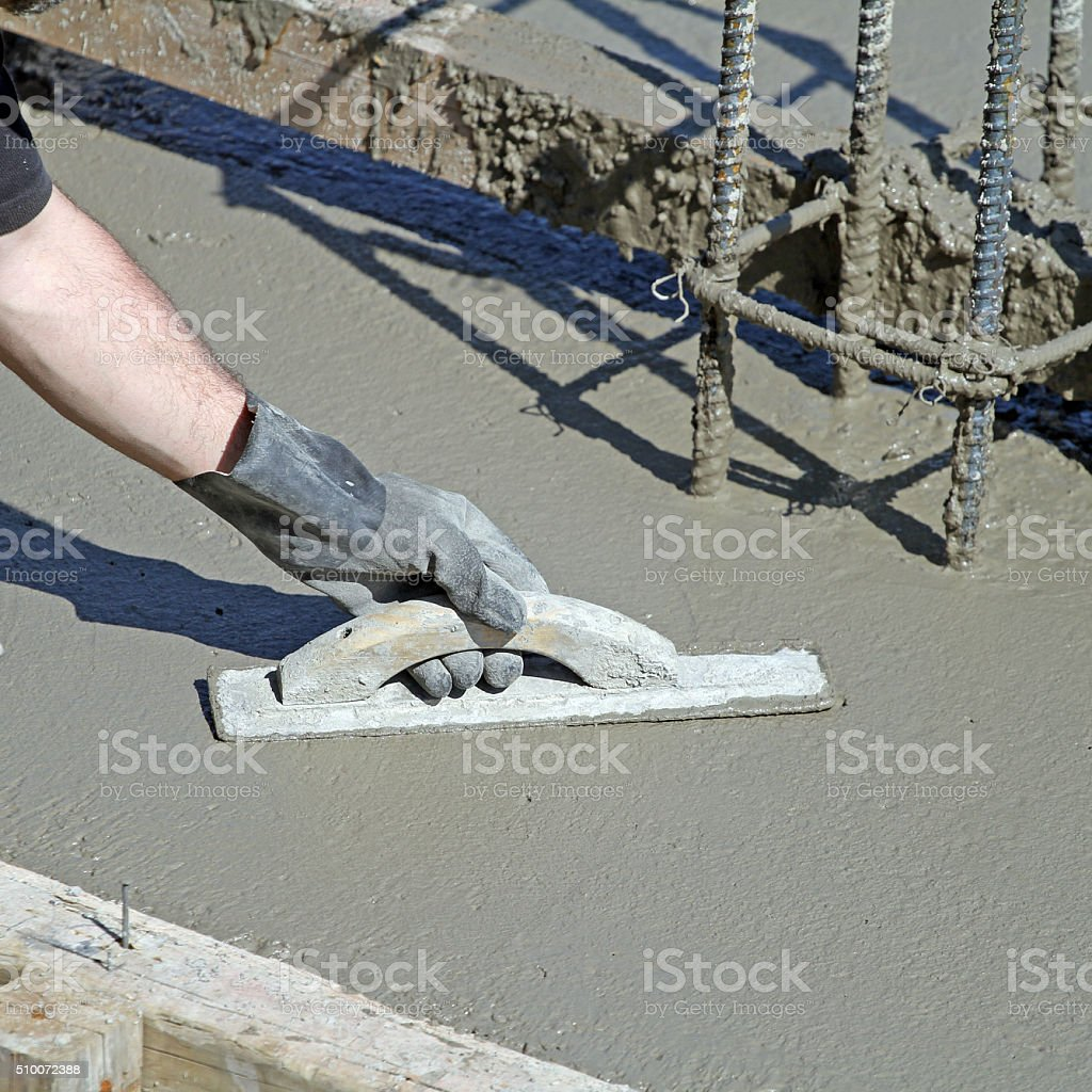 Troweling Concrete On A New Building Construction Site stock photo
