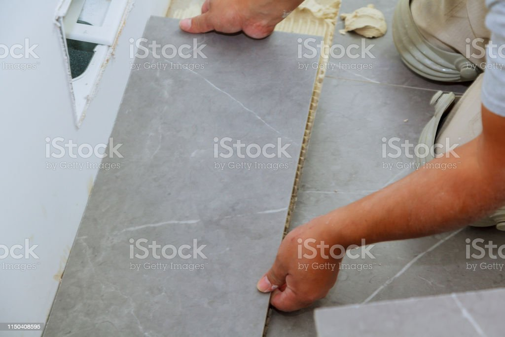 Troweling Mortar A Concrete Floor In Preparation For Laying Floor