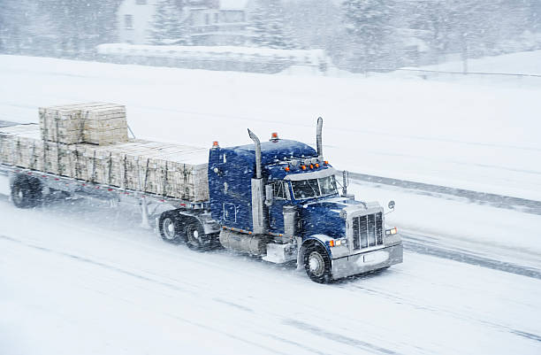 Truck and blizzard stock photo