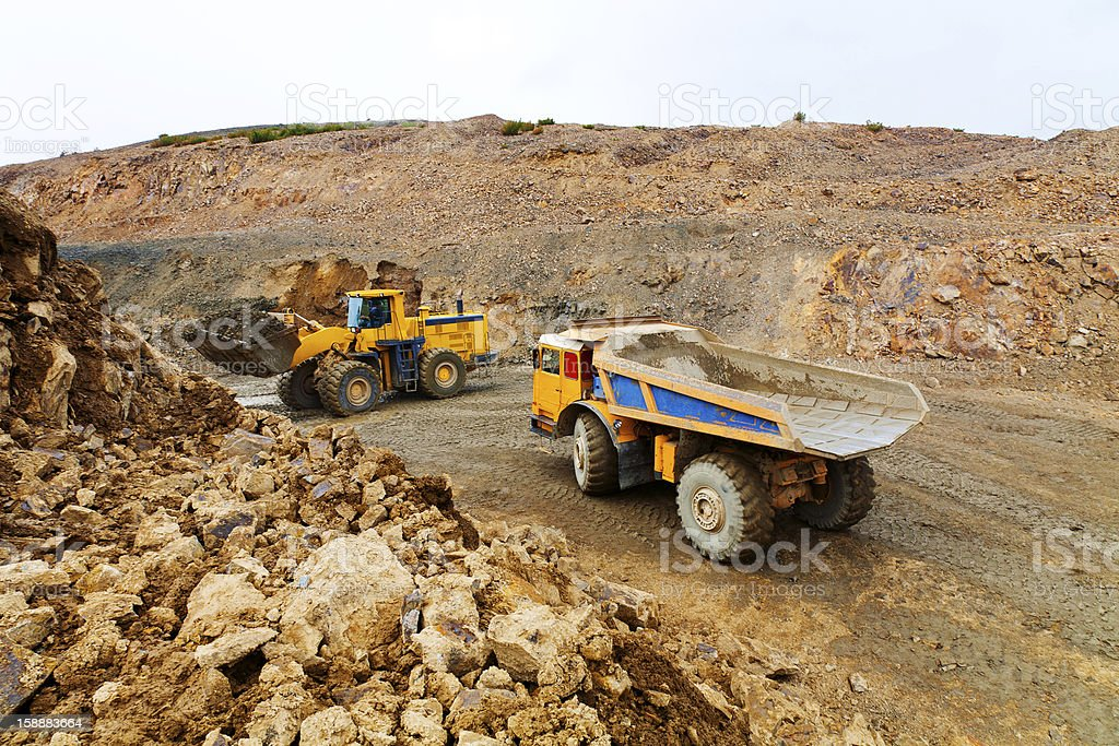 Truck and bulldozer in quarry stock photo