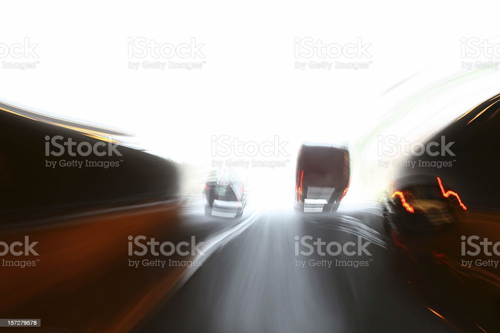 Truck and car at the end of tunnel royalty-free stock photo