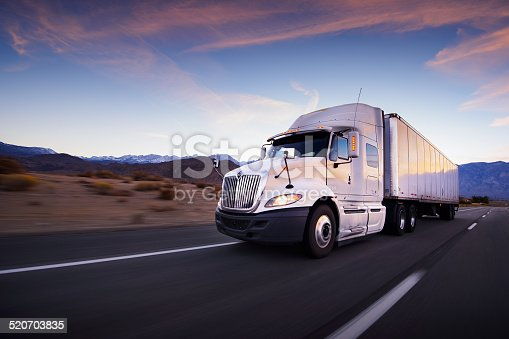 istock Truck and highway at sunset - transportation background 520703835