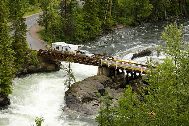 Truck and trailer crossing a river stock photo