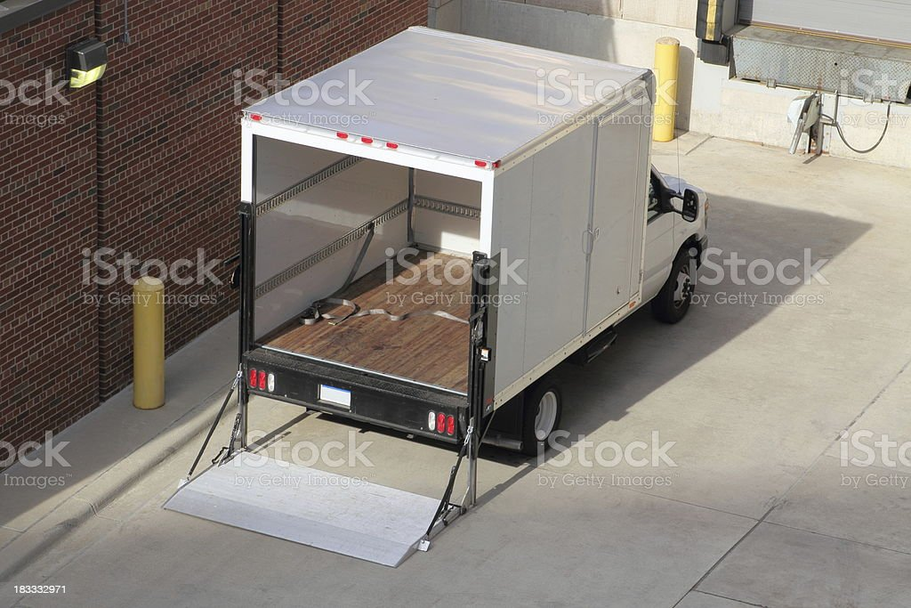Truck at Loading Dock with Open Cargo Bay stock photo