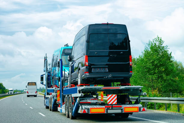 truck carrier with mini vans in road of slovenia - land vehicle stock photos and pictures