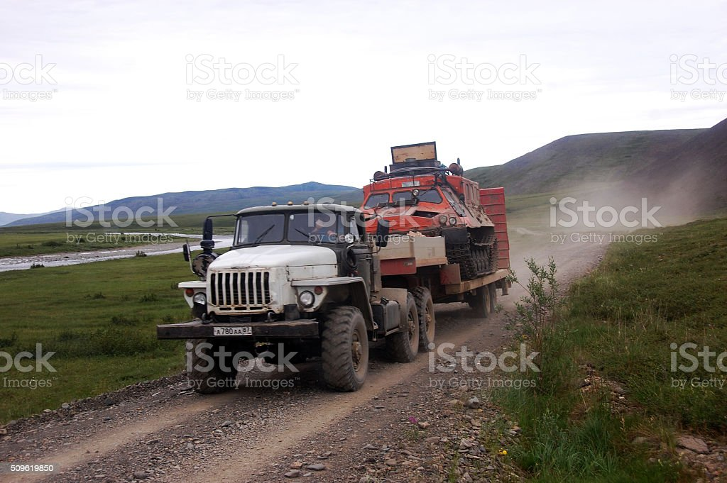 truck carries allterrain tracked vehicle at gravel road tundra stock photo more pictures of. Black Bedroom Furniture Sets. Home Design Ideas