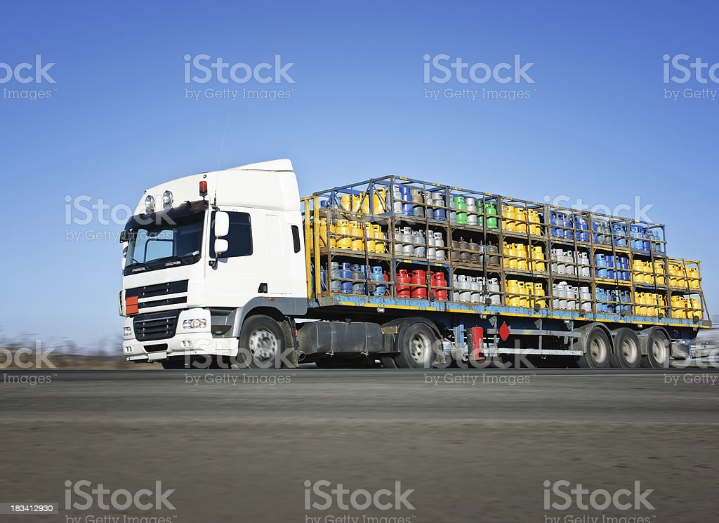 truck carrying LPG bottles stock photo
