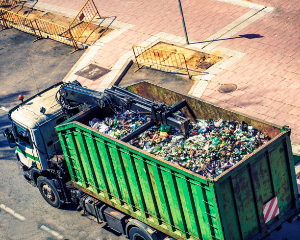 truck collecting glass for recycling top view of green truck collecting glass for recycling in the city bottle bank stock pictures, royalty-free photos & images