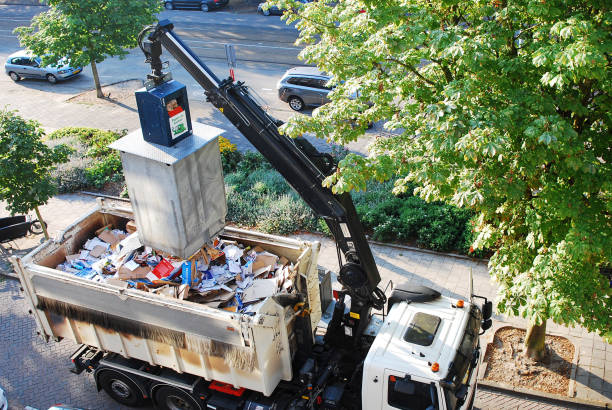 Truck collecting paper and cartons for recycling. stock photo