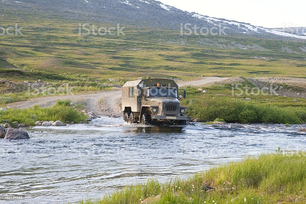 Truck crossing a river royalty-free stock photo
