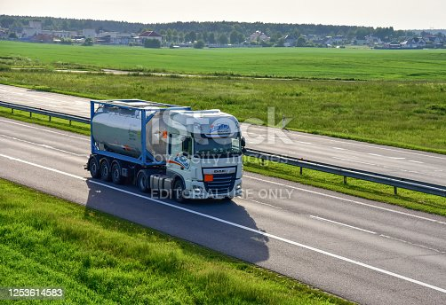 Russia, Moskow region - JUN 07, 2020:Truck DAF XF Super Space Cab by «Eurotter Logistyka» with Tank Container driving along highway. Petrochemical products delivery by roads. Services and Transport logistics