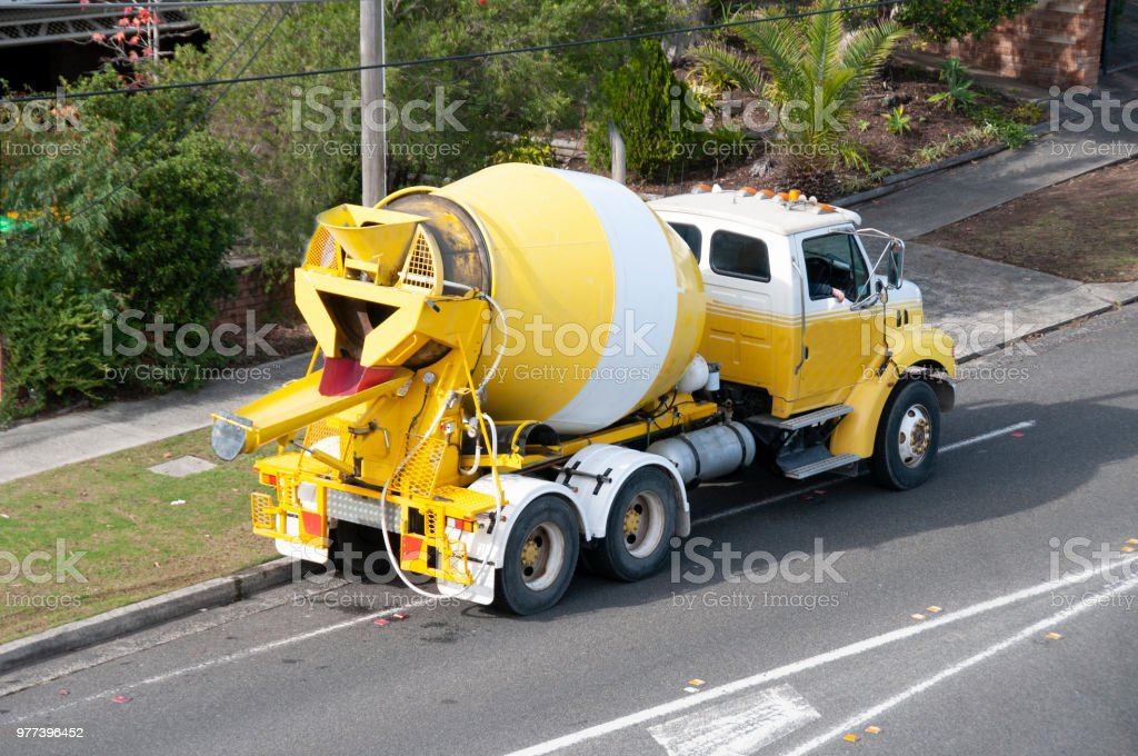 Truck delivering concrete on a suburben road. stock photo