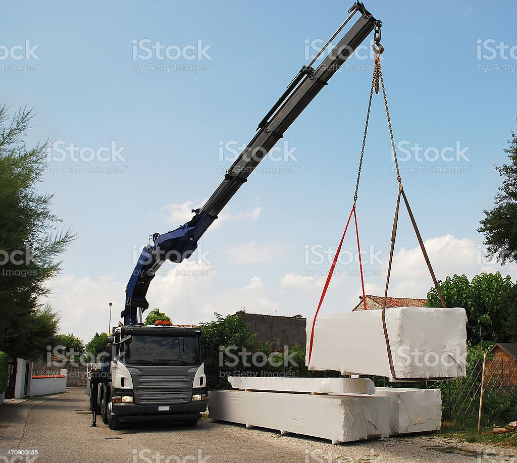 Truck Delivering Wood Packages stock photo