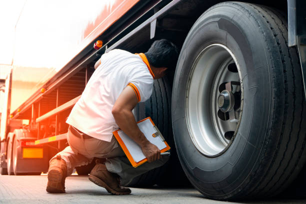 truck diver inspecting safety daily check a truck tires. - transport truck tyres foto e immagini stock