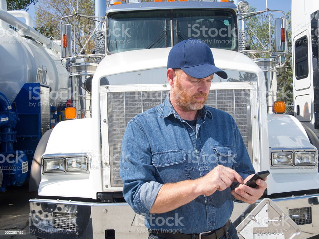 Truck Driver and Mobile Phone stock photo