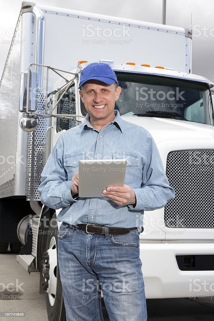 Truck Driver and PC royalty-free stock photo