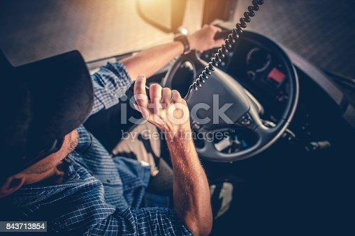 istock Truck Driver CB Radio Talk 843713854