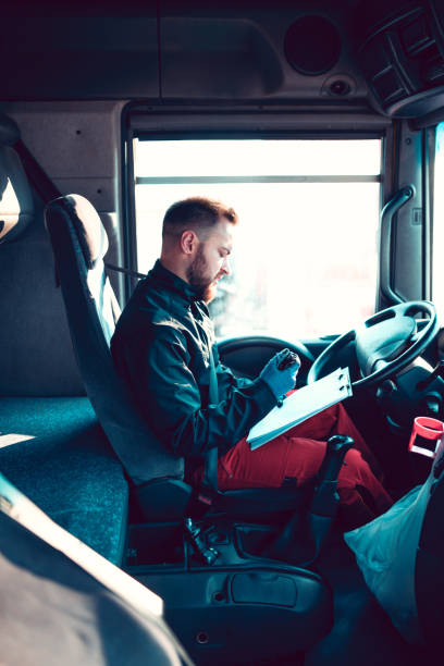 Truck Driver Checking Delivery Information stock photo