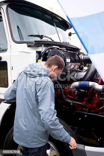 Truck Driver Checking Operation Engine Semi Truck With