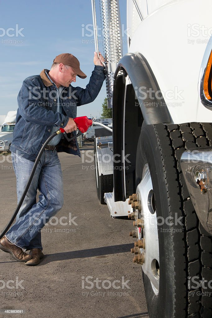 Truck Driver Fuel Up stock photo