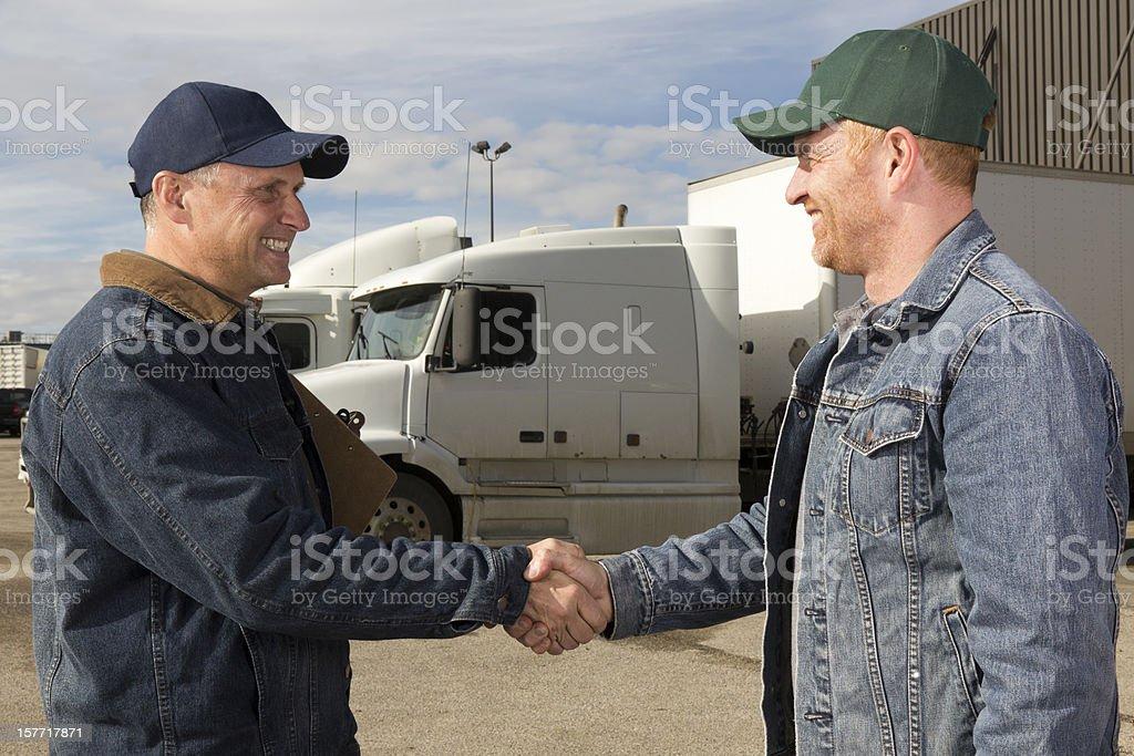 Truck Driver Handshake royalty-free stock photo