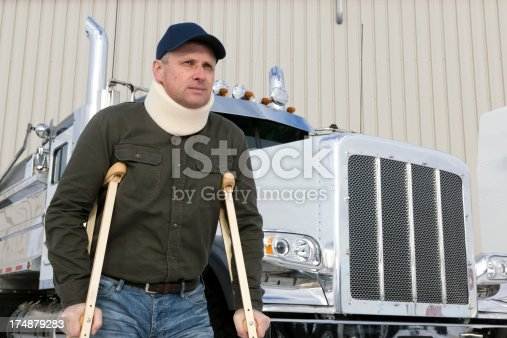 A royalty free image from the trucking industry of an injured truck driver
